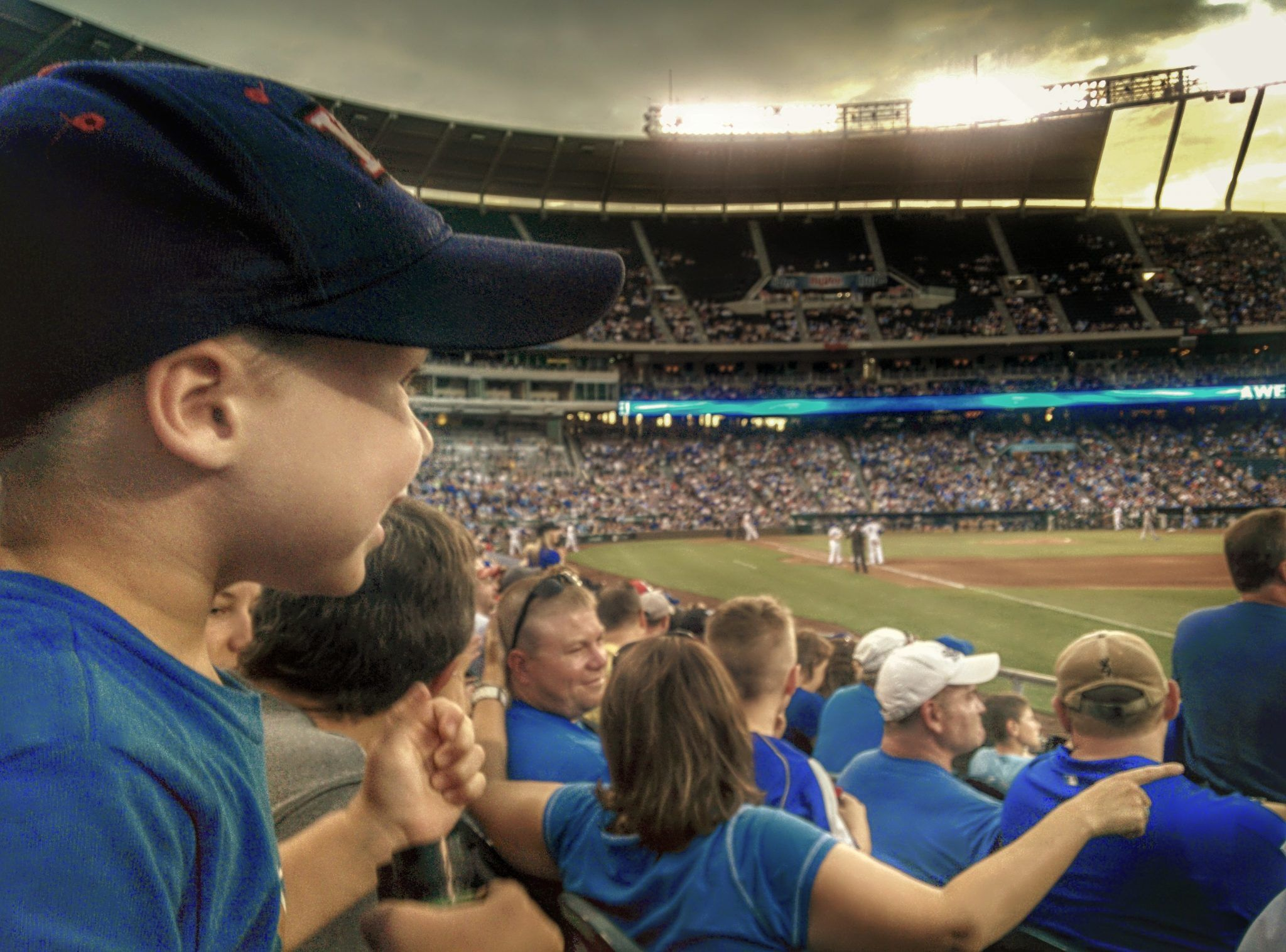 Kid watching the Kansas City Royals