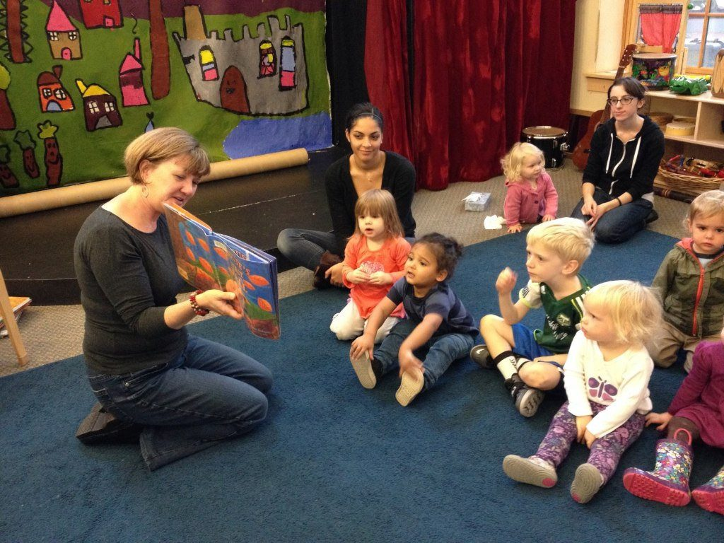 Teacher at Daycare reading to kids