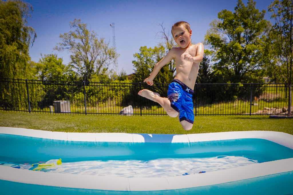 boy-jumping-into-pool