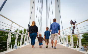 family-walking-on-bridge