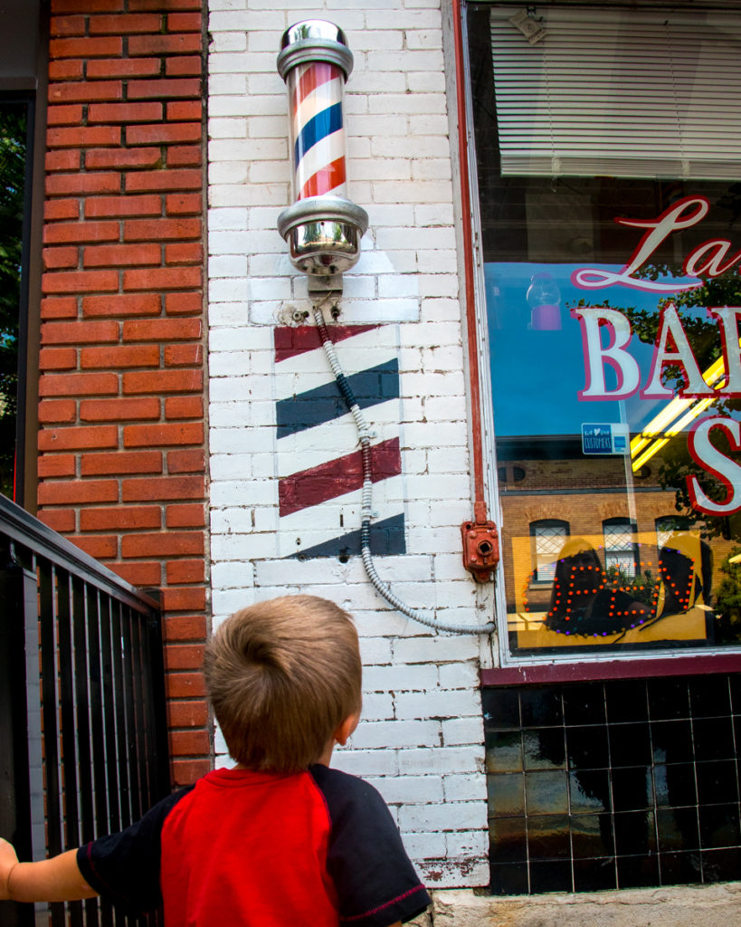 Child Looking At Barber Swirls