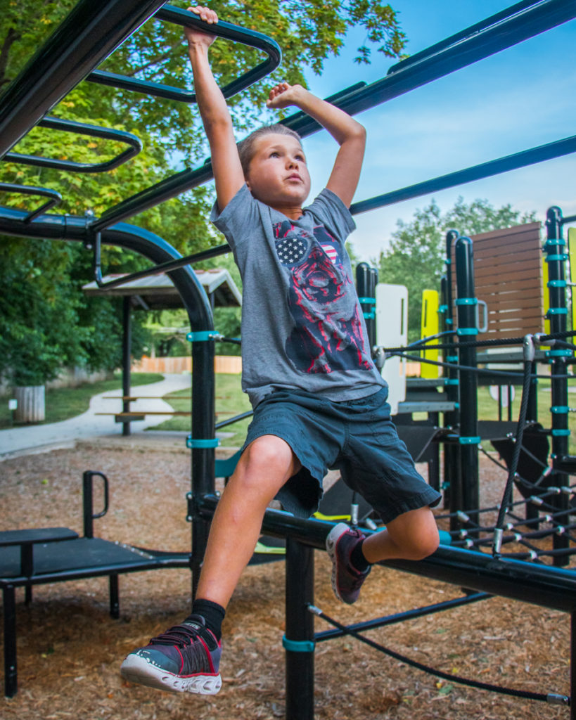 Child Hanging from Monkey Bars