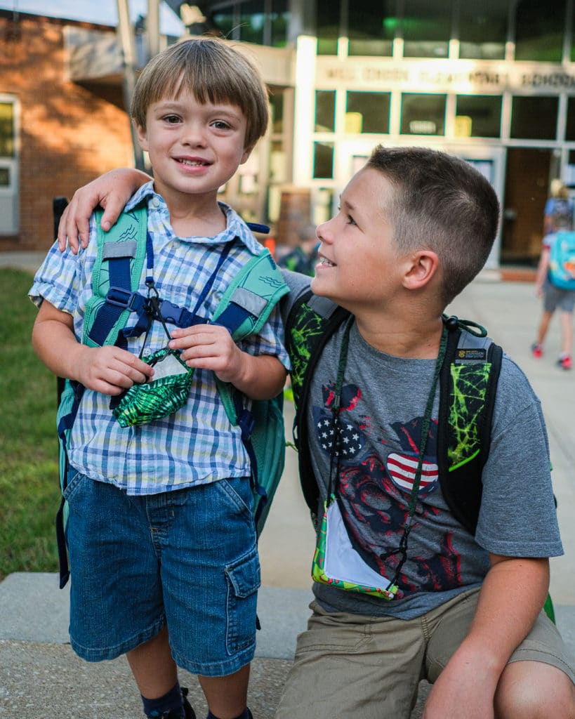 Brothers hugging on their first day of kindergarten