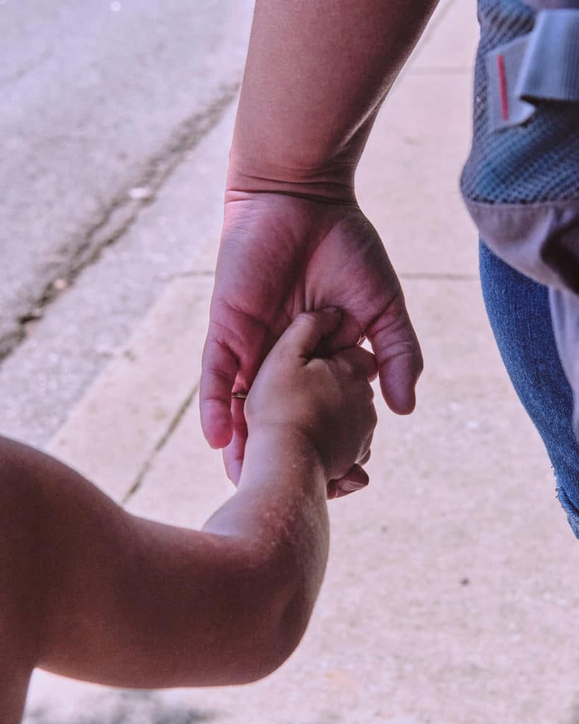 Mom and Son holding hands - Parenting through the loss of a Loved One